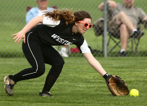 4-14-17<br /> Western vs Tipton softball<br /> Sydney Record scoops up the ball in the outfield.<br /> Kelly Lafferty Gerber | Kokomo Tribune