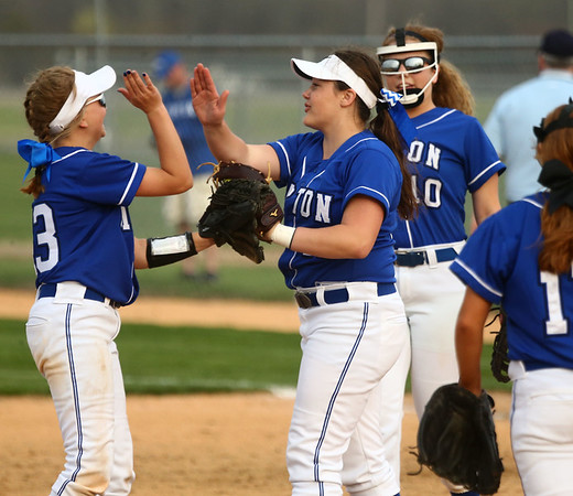 4-14-17<br /> Western vs Tipton softball<br /> Tipton pitcher Claire Norred, center, highfives teammates after Norred makes a catch for an out.<br /> Kelly Lafferty Gerber | Kokomo Tribune