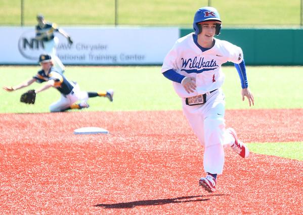 4-8-17<br /> Kokomo baseball vs SB Riley<br /> Kokomo' Justin Hurlock runs to third.<br /> Kelly Lafferty Gerber | Kokomo Tribune