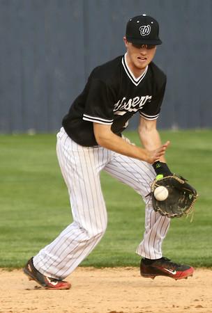4-26-17<br /> Cass vs Western baseball<br /> Western's Cooper O'Neal scoops up the ball.<br /> Kelly Lafferty Gerber   Kokomo Tribune