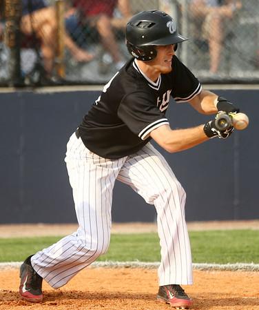 4-26-17<br /> Cass vs Western baseball<br /> Western's Cooper O'Neal bunts.<br /> Kelly Lafferty Gerber | Kokomo Tribune