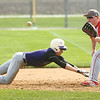 4-15-17<br /> Northwestern vs Mississenewa baseball<br /> NW's Ethan Breisch slides back to first safely as Miss. Garrison Smith tries to pick him off.<br /> Kelly Lafferty Gerber | Kokomo Tribune
