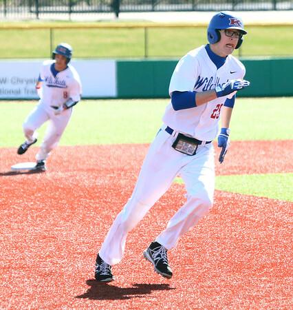 4-8-17<br /> Kokomo baseball vs SB Riley<br /> Nate Hemmerich runs to third.<br /> Kelly Lafferty Gerber | Kokomo Tribune
