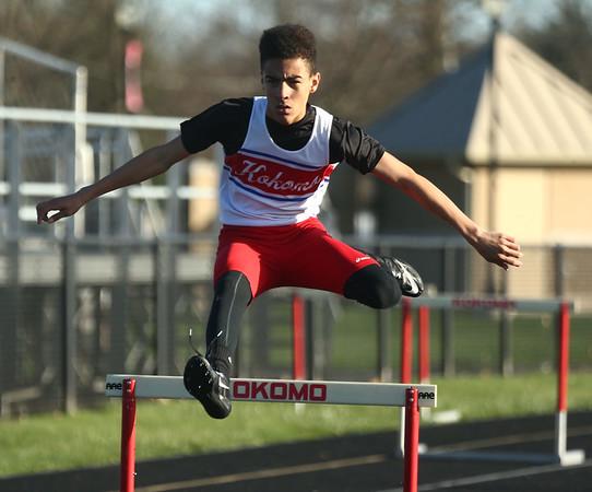 4-7-17<br /> Kokomo boys track and field<br /> Quincy Armstrong in the 300 m hurdles.<br /> Kelly Lafferty Gerber | Kokomo Tribune