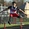 4-7-17<br /> Kokomo boys track and field<br /> Quincy Armstrong in the 300 m hurdles.<br /> Kelly Lafferty Gerber | Kokomo Tribune