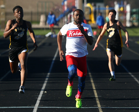 4-7-17<br /> Kokomo boys track and field<br /> Andrecus Eddington in the 100 m dash.<br /> Kelly Lafferty Gerber | Kokomo Tribune