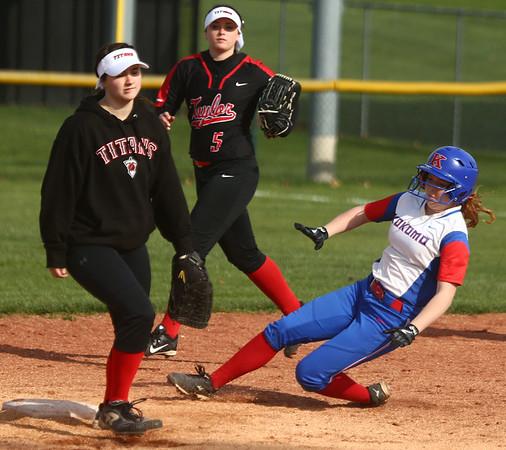 4-11-17<br /> Kokomo vs Taylor softball<br /> Kokomo's Kiley Trine slides safely to second base.<br /> Kelly Lafferty Gerber | Kokomo Tribune