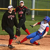 4-11-17<br /> Kokomo vs Taylor softball<br /> Kokomo's Kiley Trine slides safely to second base.<br /> Kelly Lafferty Gerber | Kokomo Tribune