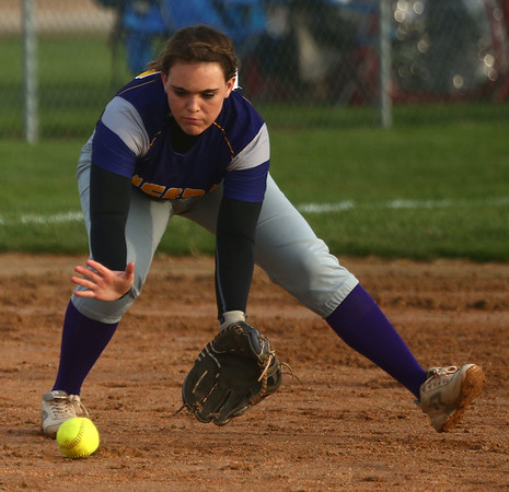 2-14-17<br /> Northwestern vs Oak Hill softball<br /> Sara Hughes scoops up the ball.<br /> Kelly Lafferty Gerber | Kokomo Tribune
