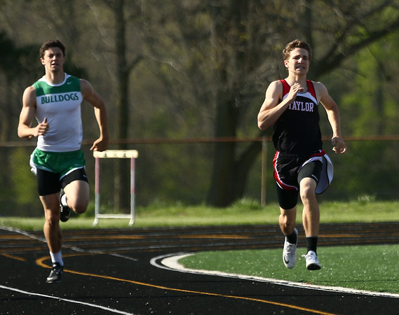 4-25-17<br /> Taylor track<br /> Clay Murray in the 400 m dash.<br /> Kelly Lafferty Gerber | Kokomo Tribune