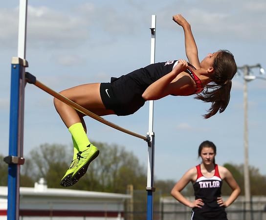 4-25-17<br /> Taylor track<br /> Alison Pemberton in the high jump<br /> Kelly Lafferty Gerber   Kokomo Tribune