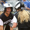 4-14-17<br /> Western vs Tipton softball<br /> Western's Karlyne Shepherd, left, celebrates with Tori Turner after they both score runs when Emma Key hit a home run.<br /> Kelly Lafferty Gerber | Kokomo Tribune