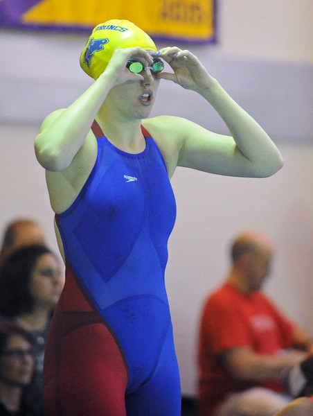 Molly Green adjusts her goggles before diving in during the 400-yard freestyle relay at the state swim meet on Saturday, Nov. 4 at the Campbell County Aquatic Center. Mike Pruden | The Sheridan Press