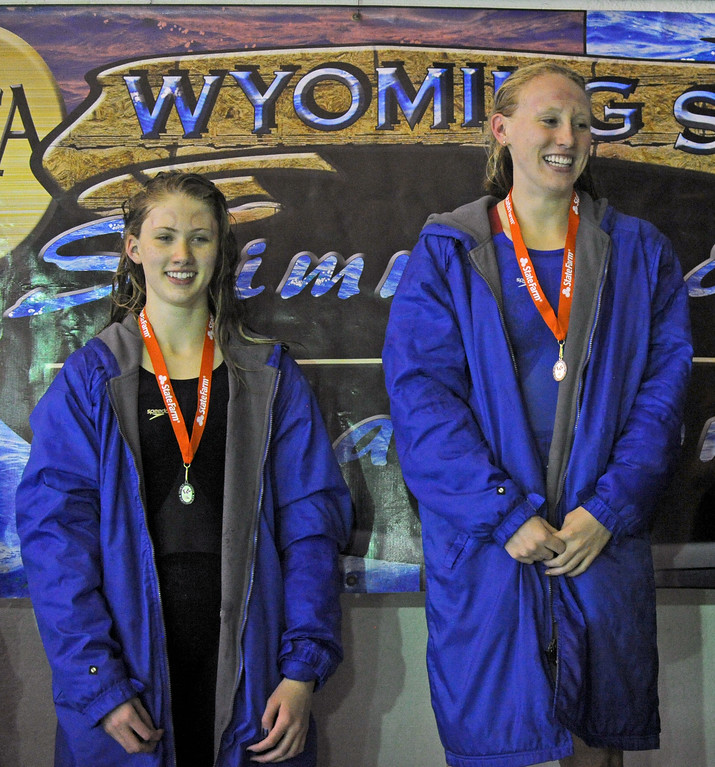 Piper Carroll, left, and Molly Green receive their medals after finishing second and first, respectively, in the 100-yard backstroke during the state swim meet on Saturday, Nov. 4 at the Campbell County Aquatic Center. Mike Pruden   The Sheridan Press