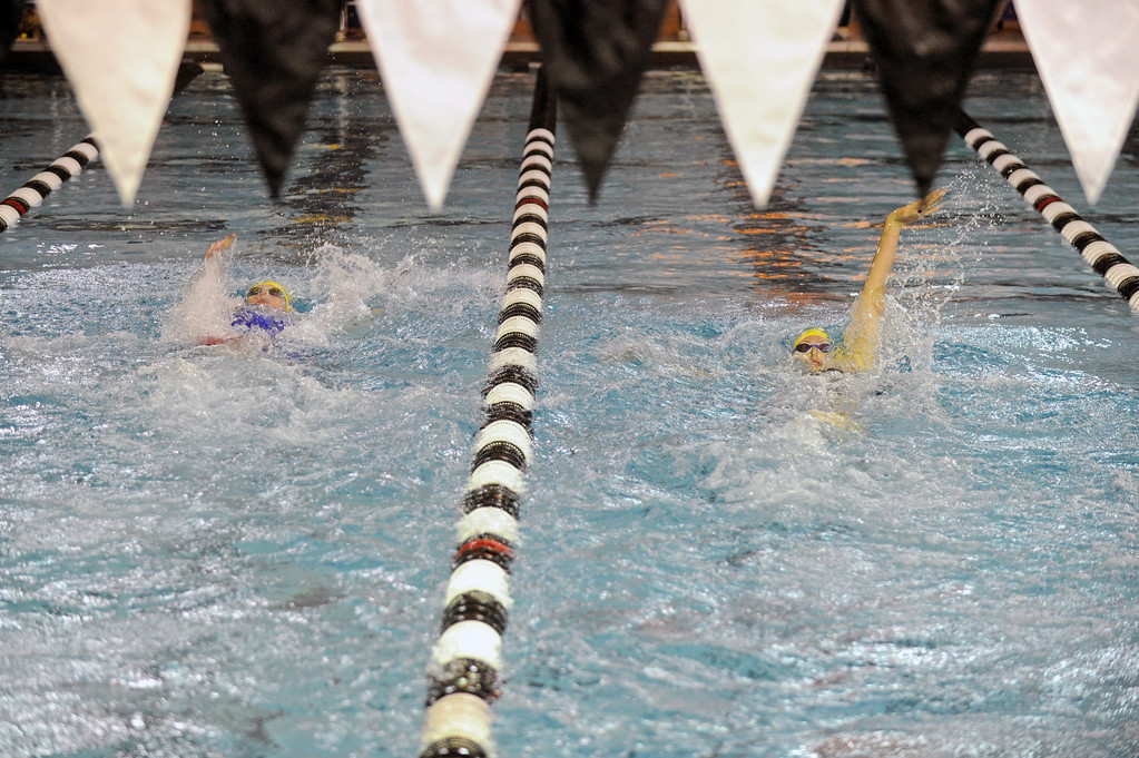 Molly Green, left, and Piper Carroll compete in the 100-yard backstroke during the 4A girls swimming state meet on Saturday, Nov. 4 at the Campbell County Aquatic Center. The Sheridan duo finished first and second, respectively, in the event. Mike Pruden   The Sheridan Press