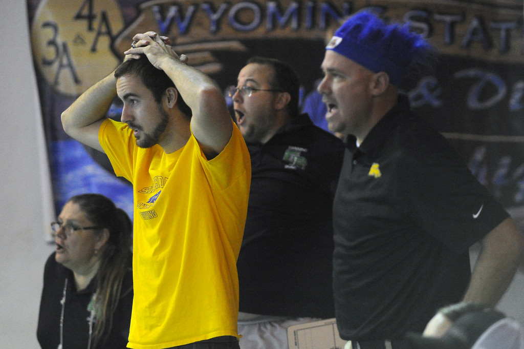 Sheridan assistant coach Adam Martin, left, intently watches the 200-yard freestyle relay as head coach Brent Moore, right, cheers at the state swim meet on Saturday, Nov. 4 at the Campbell County Aquatic Center. Mike Pruden   The Sheridan Press