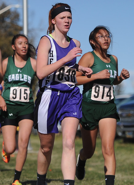 Ryan Patterson   The Sheridan Press Tongue River's Angel Richards, left, and RaeShawna Red Star compete in Saturday's state cross country meet at the Veterans Affairs Medical Center campus in Sheridan.