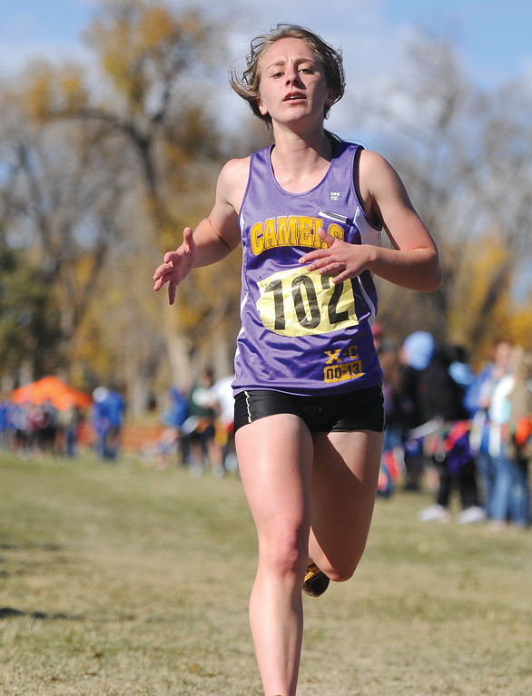 Ryan Patterson | The Sheridan Press Josie Destefano from Campbell County High School finishes at the state cross country meet Saturday at the Veterans Affairs Medical Center campus in Sheridan.