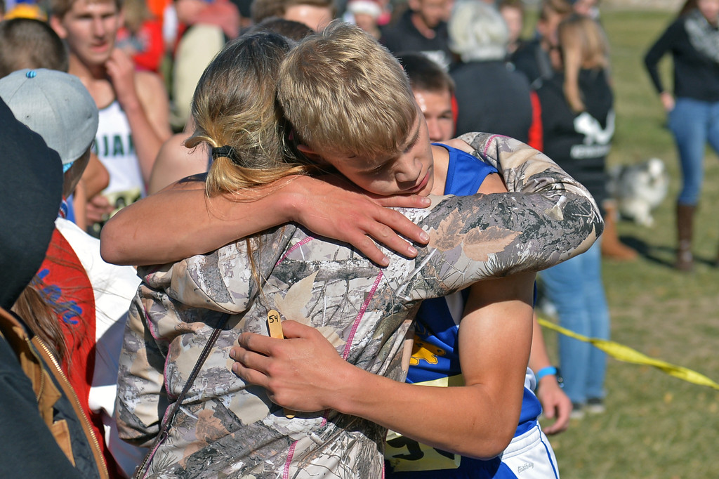 Sheridan's Wyatt Shaw gets an embrace at the finish line of the 4A boys state cross-country meet on Saturday, Oct. 21 at the Veterans Affairs Medical Center campus in Sheridan. Mike Pruden | The Sheridan Press