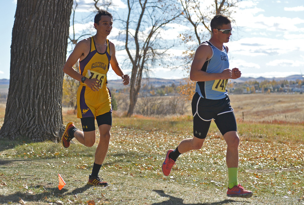 Gillette's Zane Younkin, left, runs with Cheyenne East's Jaden Bickell during the boys 4A state cross-country meet on Saturday, Oct. 21 at the Veterans Affairs Medical Center campus in Sheridan. Mike Pruden | The Sheridan Press