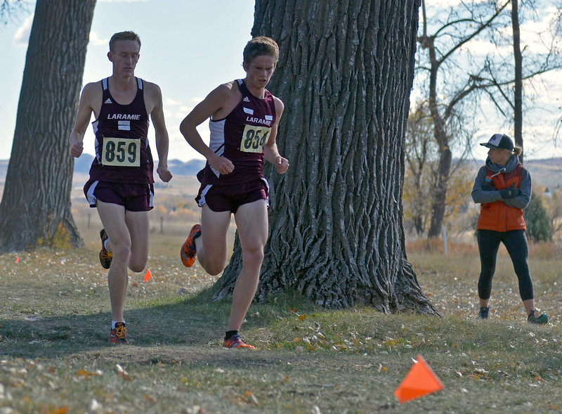 Laramie's Albert Steiner, left, and Philip Henry set the pace during the boys 4A state cross-country meet on Saturday, Oct. 21 at the Veterans Affairs Medical Center campus in Sheridan. The Plainsmen duo finished first and second, respectively. Mike Pruden | The Sheridan Press