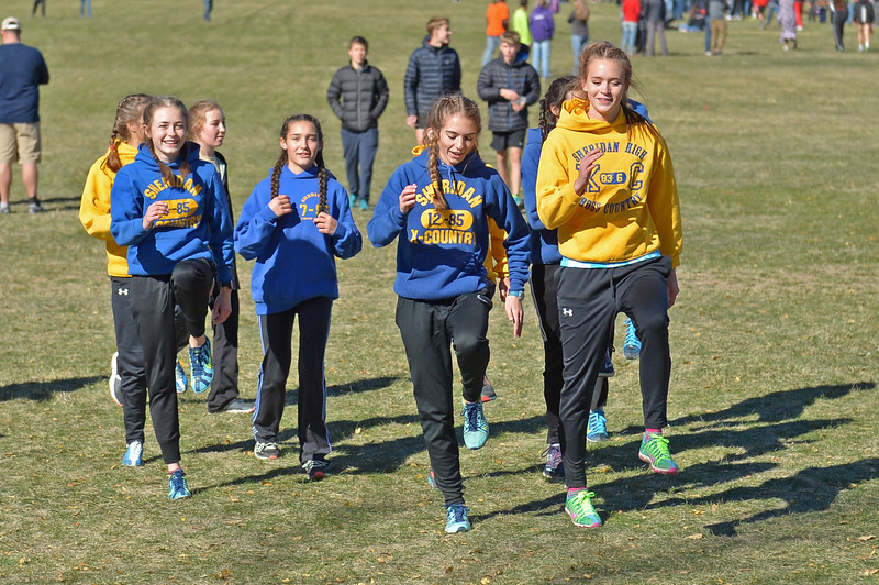 The Sheridan High School girls cross-country team warms up before the start of the 4A race on Saturday, Oct. 21 at the Veteran Affairs Medical Central in Sheridan. Mike Pruden | The Sheridan Press