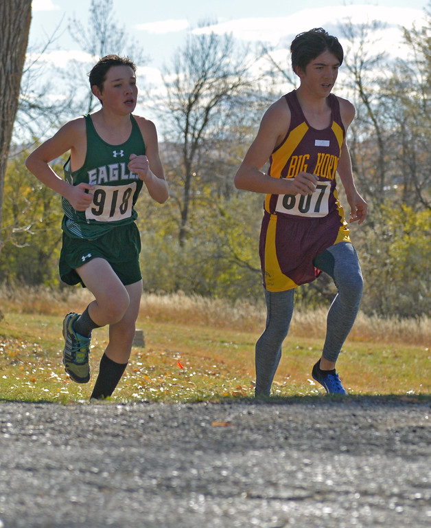 Tongue River's Azariah Benevedes, left, and Big Horn's Noah Harvey run neck-and-neck in the boys 2A cross-country state meet on Saturday, Oct. 21 at the Veterans Affairs Medical Center campus in Sheridan. Mike Pruden | The Sheridan Press