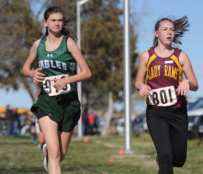 Ryan Patterson   The Sheridan Press Tongue River's Laura Walters and Elizabeth Foley of Big Horn run in Saturday's state cross country meet at the Veterans Affairs Medical Center campus in Sheridan.