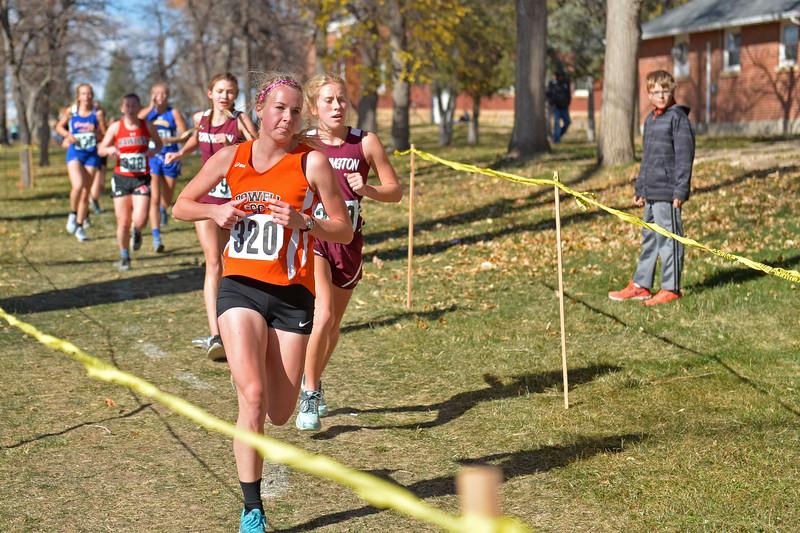 Powell's Gracen Curtis leads a pack of runners around the course during the girls 3A state cross-country meet on Saturday, Oct. 21 at the Veteran Affairs Medical Central in Sheridan. Mike Pruden   The Sheridan Press