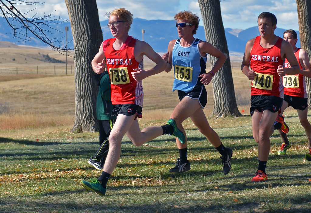 Cheyenne Central's Austin Stephen, left, and Dalton Stoddard, right, sandwich East's Jeremy Rief during the boys 4A state cross-country meet on Saturday, Oct. 21 at the Veterans Affairs Medical Center campus in Sheridan. Mike Pruden | The Sheridan Press