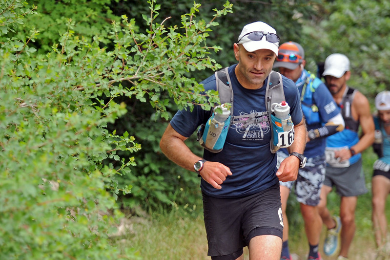 Brent Crumley of Boise, Idaho, dodges a branch during the Bighorn Mountain Wild and Scenic Trail Run 100-mile race on Friday, June 16 in Tongue River Canyon. Mike Pruden   The Sheridan Press