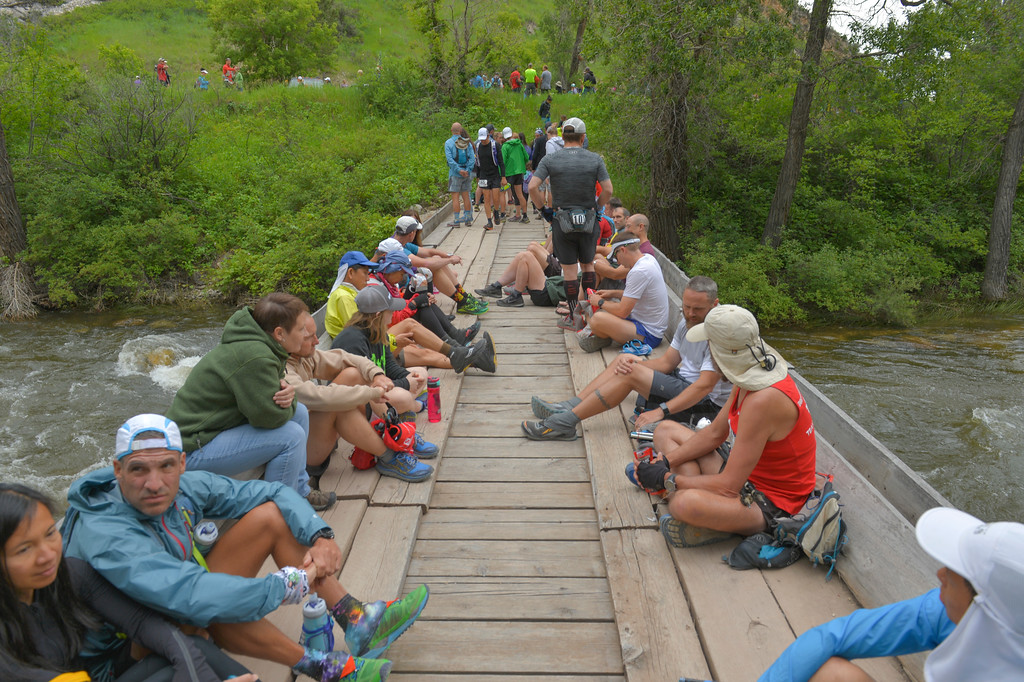 Justin Sheely | The Sheridan Press<br /> Competitors wait on a bridge prior to the start of the 100-mile run during the 25th Bighorn Mountain Wild and Scenic Trail Run Friday morning in the Tongue River Canyon near Dayton. Hundreds of runners from across the globe visit Sheridan and Dayton, Wyoming, to compete in the ultra marathons.