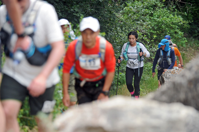 Adrienne Vuong of Bloomfield, New Jersey, hikes the trail during the Bighorn Mountain Wild and Scenic Trail Run 100-mile race on Friday, June 16 in Tongue River Canyon. Mike Pruden | The Sheridan Press