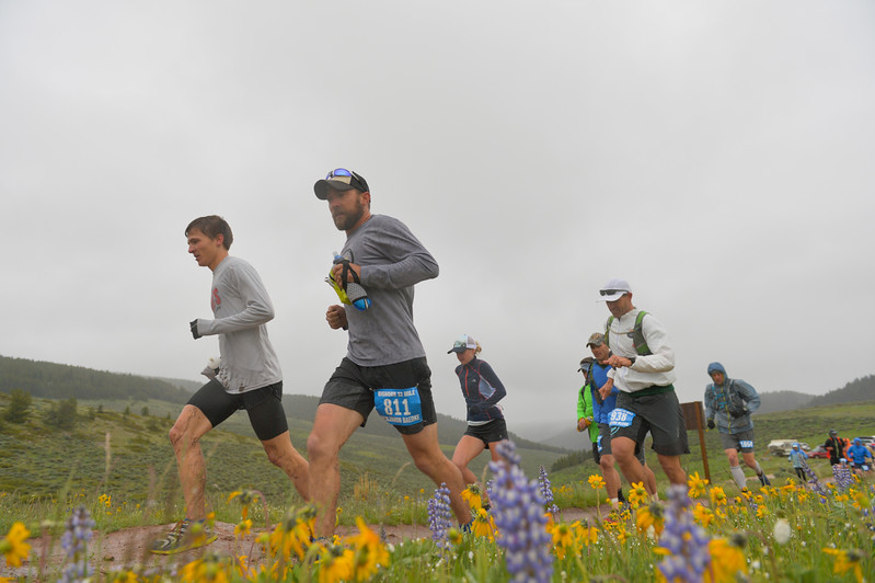 Justin Sheely   The Sheridan Press<br /> Runners dash up the hill at the start of the 32-mile race during the 25th annual Bighorn Mountain Wild and Scenic Trail Run Saturday at the Dry Fork aid station. Cold rain and wind brought a soggy start to Saturday's events.