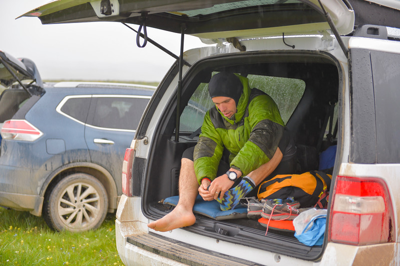 Justin Sheely   The Sheridan Press<br /> Elliot Jacobs of Hailey, Idaho, gears up under the shelter of his wagon prior to the start of the 32-mile race during the 25th annual Bighorn Mountain Wild and Scenic Trail Run Saturday at the Dry Fork aid station. Cold rain and wind brought a soggy start to Saturday's events.