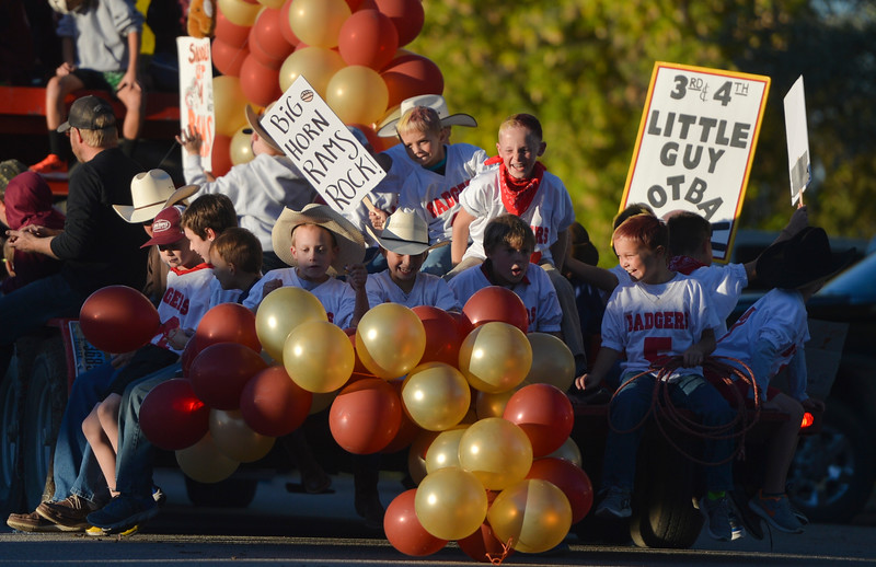 Justin Sheely | The Sheridan Press<br /> Third and Fourth-grade Little Guy Football players react as a string of balloons fall from their float during Big Horn's Homecoming Parade Thursday. The Rams play Wright football under the Friday night lights in Big Horn.