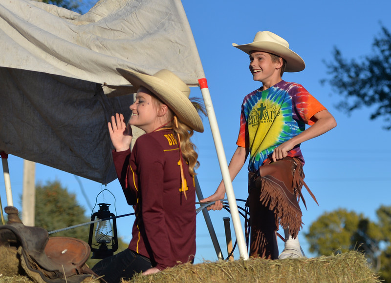 Justin Sheely | The Sheridan Press<br /> Freshmen Jersey DeHaven, left, and Brandon Cummins ride their float through Big Horn during Big Horn's Homecoming Parade Thursday. The Rams play Wright football under the Friday night lights in Big Horn.