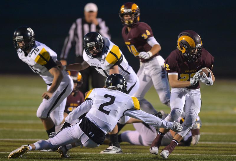 Justin Sheely | The Sheridan Press<br /> Rams' Kade Eisele runs the ball against Wright Friday night at Big Horn High School.
