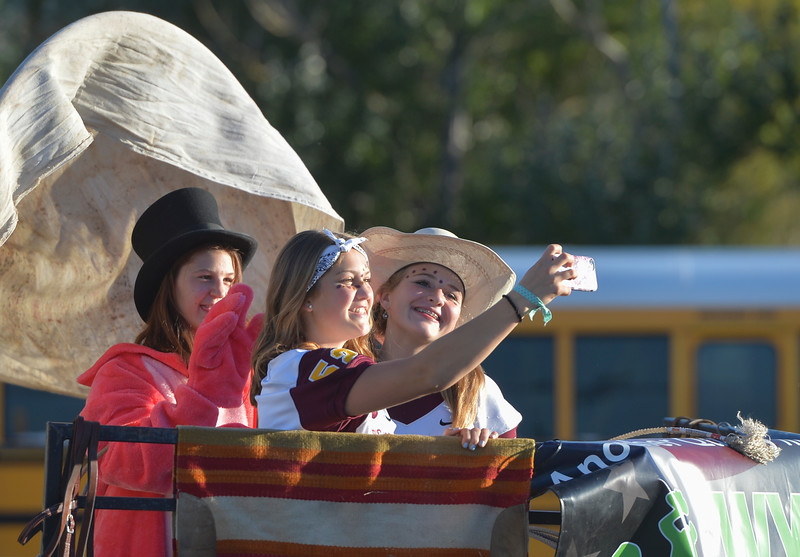 Justin Sheely | The Sheridan Press<br /> Big Horn freshmen, from left, Camryn Hecker, Madison Butler and Maggie May ride their float to the staging area during Big Horn's Homecoming Parade Thursday. The Rams play Wright football under the Friday night lights in Big Horn.
