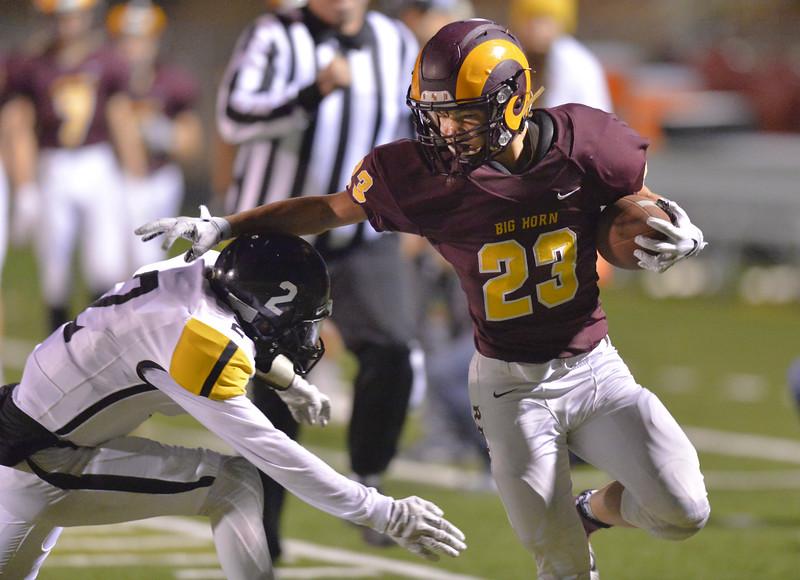 Justin Sheely | The Sheridan Press<br /> Big Horn's Kade Eisele runs the ball against Wright Friday night at Big Horn High School.