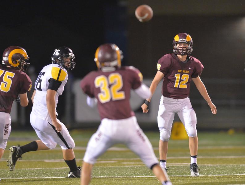Justin Sheely | The Sheridan Press<br /> Big Horn's quarterback Quinn McCafferty makes a pass to Liam Greeneish against Wright Friday night at Big Horn High School.