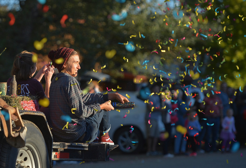 Justin Sheely | The Sheridan Press<br /> Nathaniel McAdoo fires a confetti popper during Big Horn's Homecoming Parade Thursday. The Rams play Wright football under the Friday night lights in Big Horn.