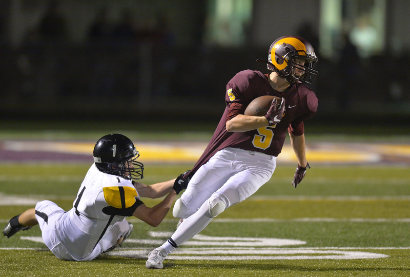 Justin Sheely | The Sheridan Press<br /> Big Horn's Will Pelissier is tackled by Wright Friday night at Big Horn High School.
