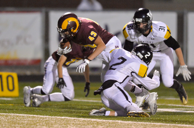 Justin Sheely | The Sheridan Press<br /> Rams' Jack Nance moves the ball against Wright Friday night at Big Horn High School.