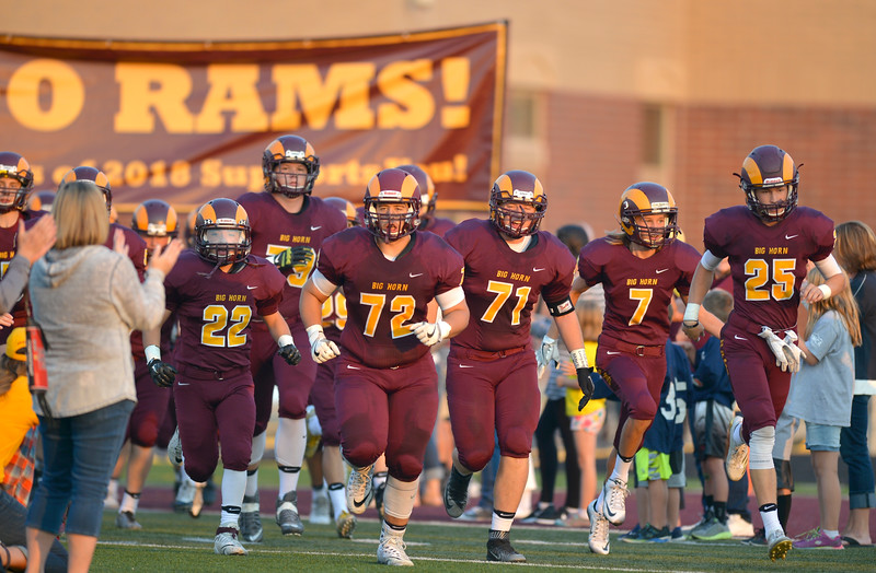 Justin Sheely   The Sheridan Press<br /> The Rams enter the field to face the Grizzlies during the first home game Friday night at Big Horn High School.