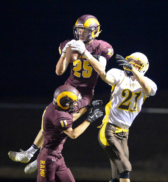 Justin Sheely | The Sheridan Press<br /> Big Horn's Kade VanDyken intercepts the ball intended for Grizzlies' Lathan May over the endzone during the Rams first home game Friday night at Big Horn High School. The Rams won 44-14 over Rocky Mountain class 1a football.
