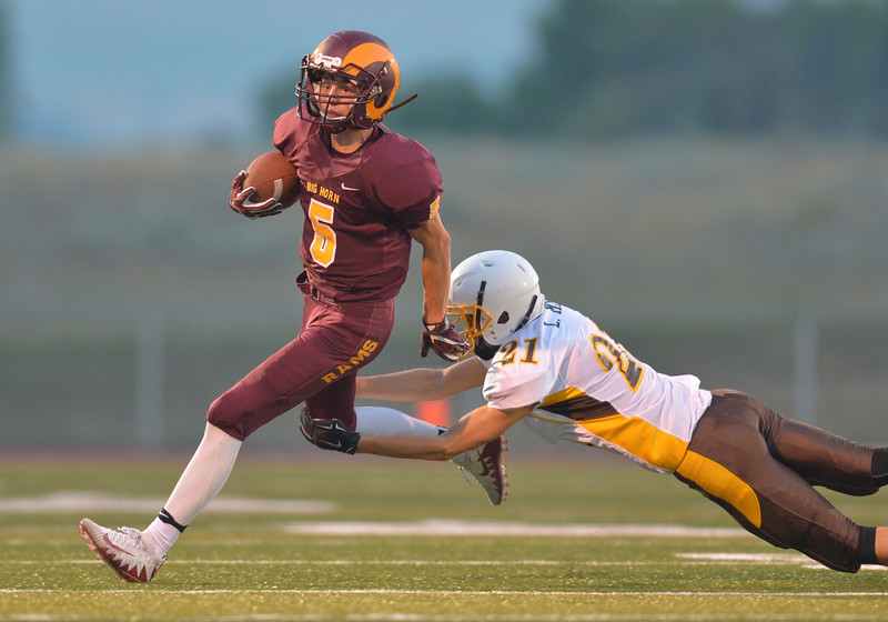 Justin Sheely| The Sheridan Press<br /> Big Horn's running back Will Pelissier throws off a tackle from Rocky Mountain's Lathan May during the Rams' first home game Friday night at Big Horn High School. The Rams won 44-14 over Rocky Mountain class 1a football.