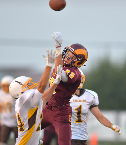 Justin Sheely   The Sheridan Press<br /> Big Horn's wide receiver Kade VanDyken and some Grizzlies leap as the ball intended for VanDyken is over thrown during the Rams first home game Friday night at Big Horn High School. The Rams won 44-14 over Rocky Mountain class 1a football.