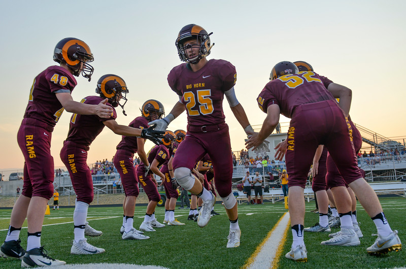Justin Sheely | The Sheridan Press<br /> Big Horn's Kade VanDyken runs onto the field as the starting players are announced during the first home game Friday night at Big Horn High School.
