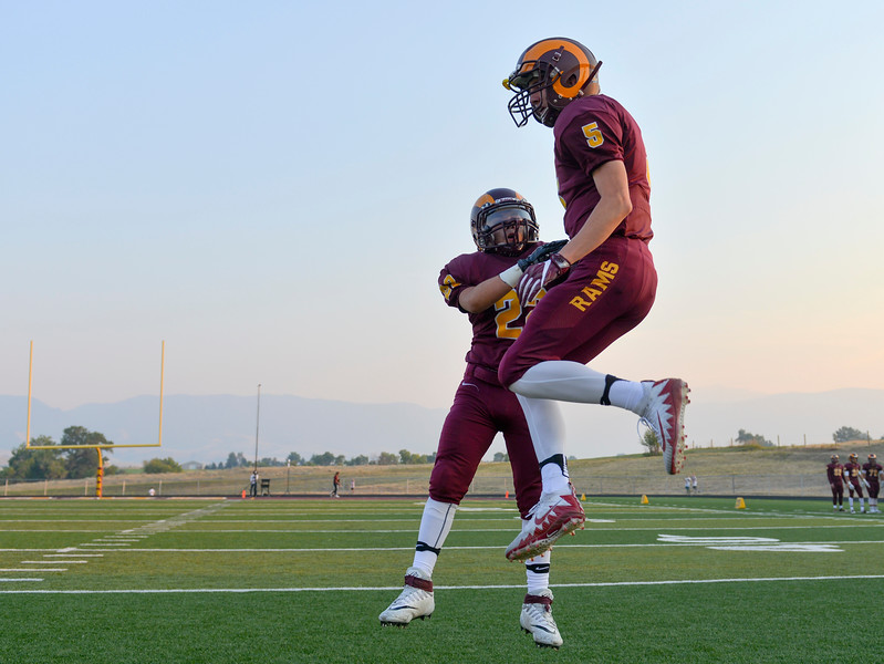 Justin Sheely | The Sheridan Press<br /> Big Horn's Roman Zuniga, left, receives Will Pelissier as the starting players are announced during the first home game Friday night at Big Horn High School.